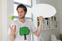 Man holding an hour glass and a speech bubble