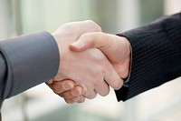 Close_up of businessmen shaking hands in an office