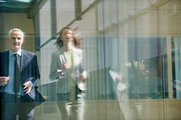 Two business executives running in the corridor