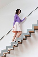 Woman moving up stairs