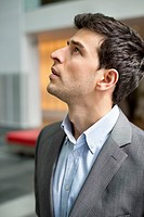 Close_up of a businessman staring