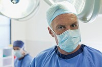 Close up portrait of surgeon under surgical lights