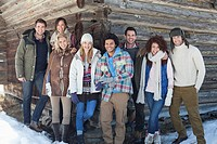 Portrait of smiling friends leaning on cabin wall