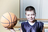 Smiling kid holding basketball