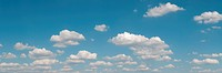gorgeous white clouds in the blue sky panoramic picture with copy_space at left top corner