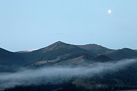 Full moon under Carpathian mountains