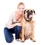 Cute young woman smiling while sitting with her bull mastiff _ isolated on white