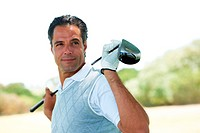 Portrait of an assured and confident mature golfer with his club along his shoulders