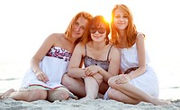 Portrait of three beautiful girls at the beach.