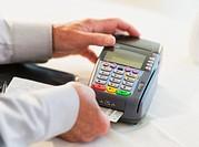 Man inserting credit card in credit card machine