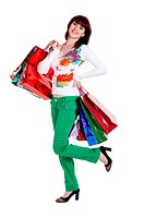 Beautiful happy woman with shopping bags isolated