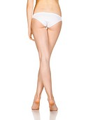 Slim tanned woman´s body. Isolated over white background.