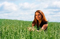 Happy young woman relaxing on nature