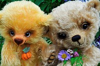 Teddy bears among flowers