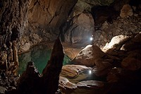 A Filipino Tour Guide Holds A Lantern Inside Sumaging Cave Or Big Cave Near Sagada, Luzon Philippines