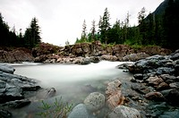 Landscape Of Flowing Water Down A Stream Over Boulders, Tofino British Columbia Canada