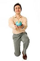 An isolated photo of a smiling man with a globe