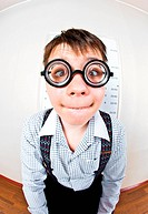 person wearing spectacles in an office at the doctor