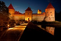 Trakai Island Castle in the lake Gatvé, Lithuania at dusk  14th century