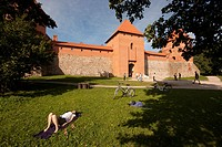 tourist relaxing in front of the Trakai Island castle, Lithuania
