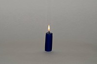 Flame of blue candle on a gray background