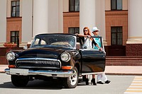 Young couple with a classic car