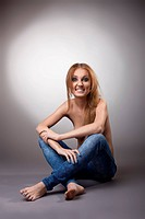 half nude woman sit in jeans