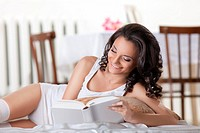 young woman read book in morning interior smile