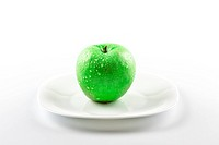 green apple on white dish