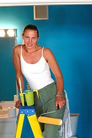 Woman at Home doing Home Improvements