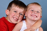 Young brothers smiling and posing for the picture