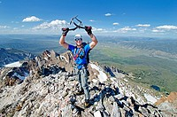 on the summit after climbing The June Couloir on the North Face of Williams Peak high above the Sawtooth Valley in the Sawtooth Mountains near the tow...