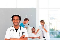 African doctor with his colleagues in the background with copy_space
