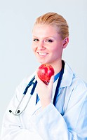 Doctor holding an apple with focus on person