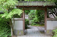 Tea Garden Gate and flagstone walkway, in the Japanese Garden in Portland. A traditional Japanese garden