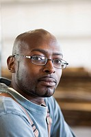 Serious Black man in eyeglasses