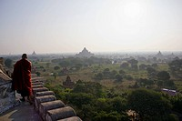 A view of the temples of Bagan, Burma and a Buddhist monk