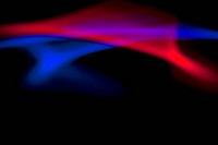 Abstract patterns of blue and red light on a black background (thumbnail)