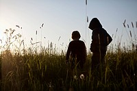 Two boys standing in a field