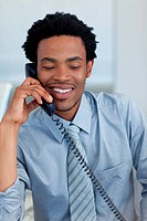 Afro_American businessman on phone in office