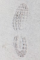 Imprint of a sports shoe in concrete