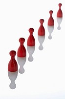 Red game pieces in a row