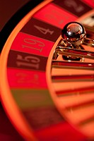 A stationary roulette wheel with the ball on number 4