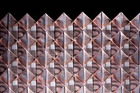 Ten Euro banknotes folded into diamond shapes and interwoven
