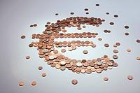 European Union coins arranged into the shape of a Euro symbol