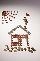 European Union coins arranged into the shape of house and sun (thumbnail)
