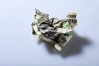 A crumpled up dollar bill