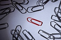 A red paperclip separated from silver paperclips (thumbnail)
