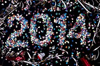 The year 2014 spelled out with confetti and surrounded by streamers