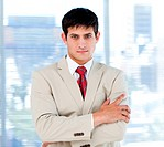 Self_assured businessman with folded arms standing